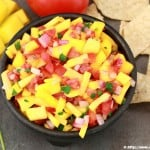 fruity salsa with chips, mango, cilantro on the side