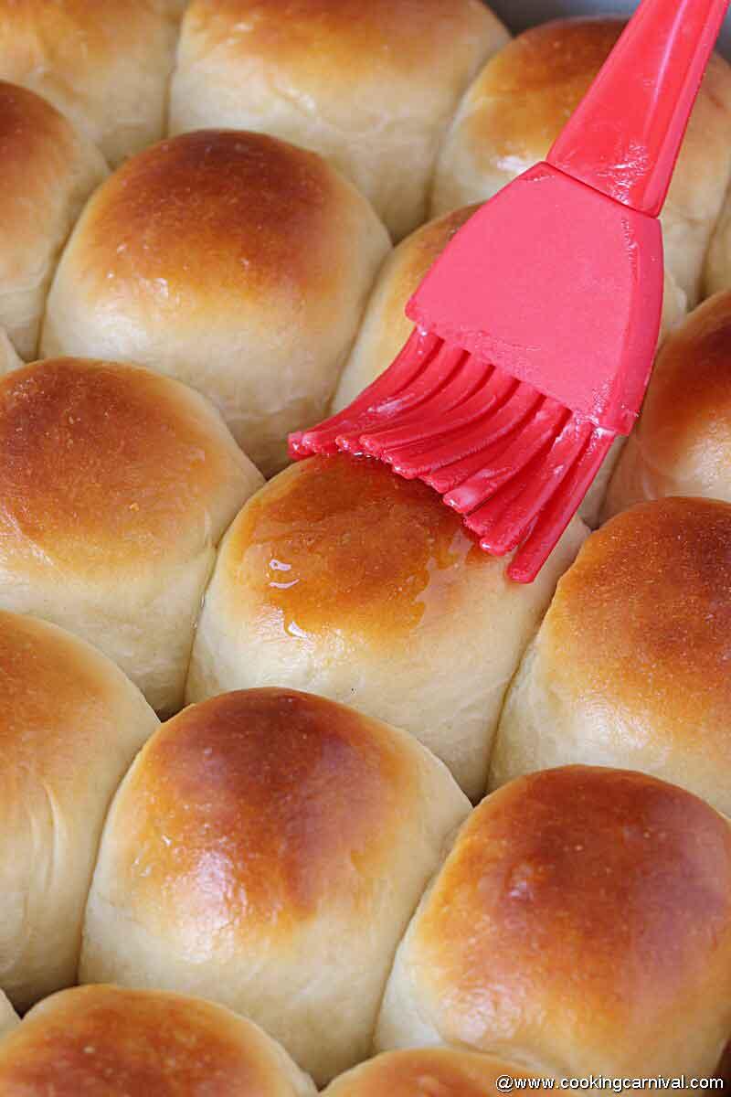 applying butter on warm rolls