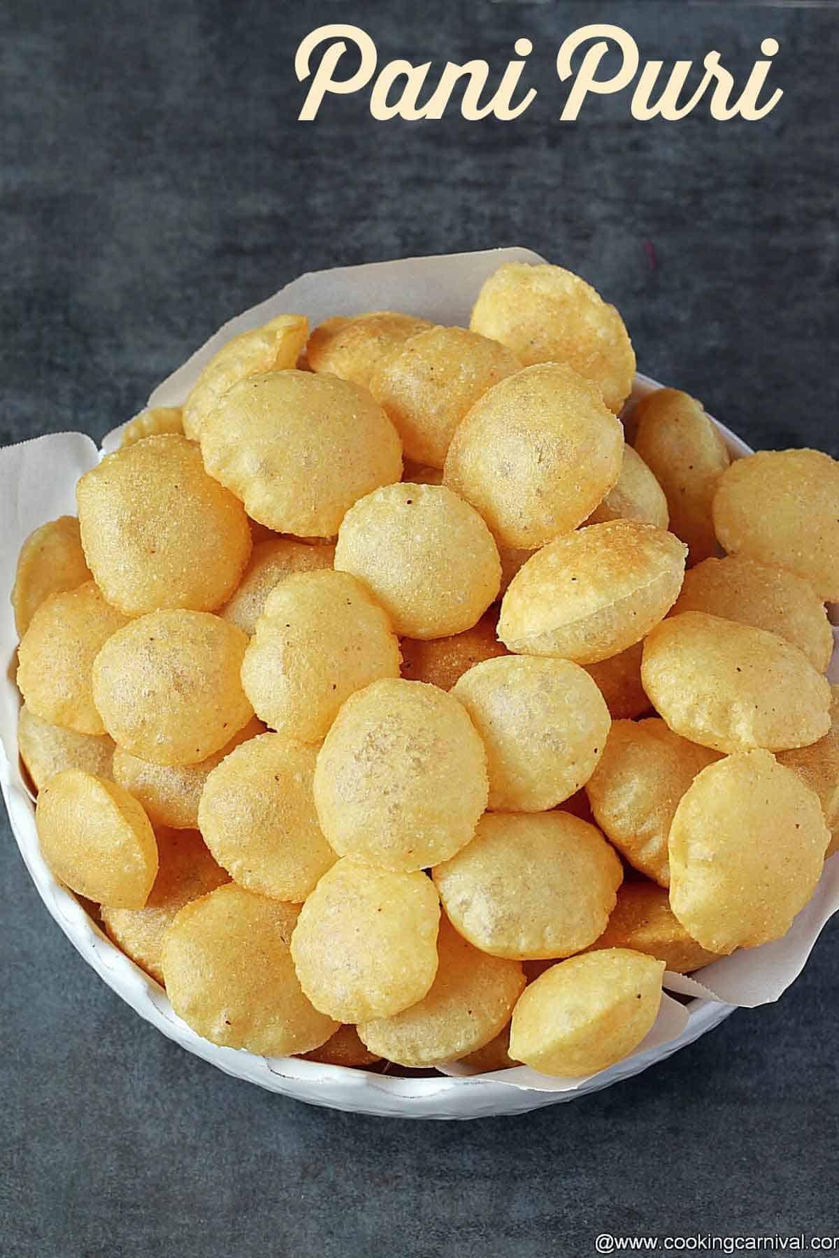 Puri for pani puri chaat in white bowl