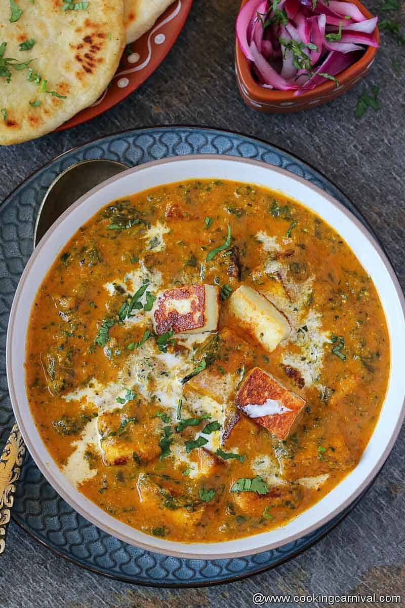 palak paneer with lasoon in white bowl