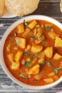 Bateta Nu Rasavalu Shak   Simple Vegan Potato curry is very common sabzi in every Gujarati thali. It is traditional Gujarati Side dish.