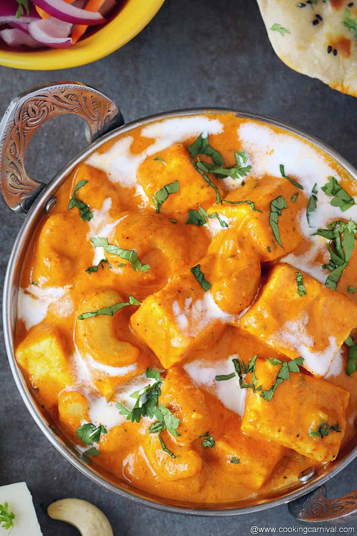 Reshmi kaju paneer garnishd with cilantro and cream