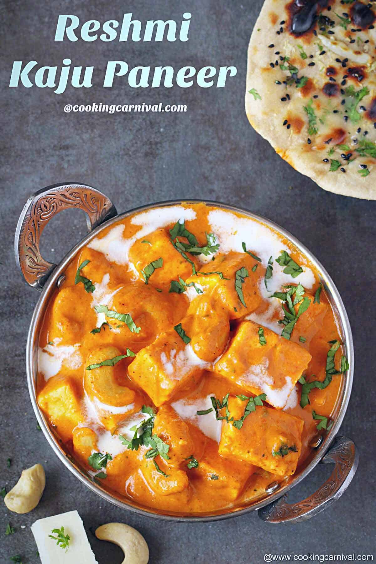 Punjabi paneer curry in a steel bowl, placed on a black tile