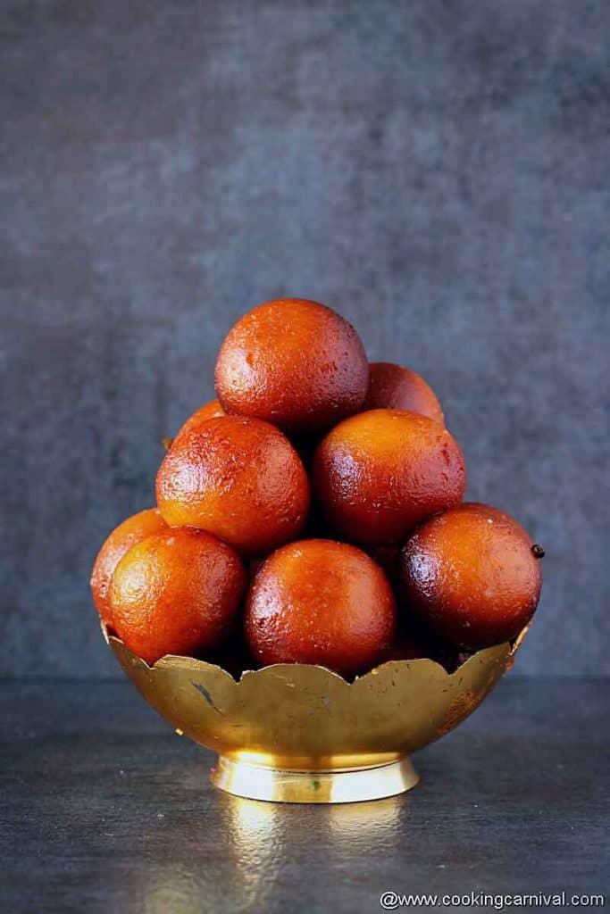 Gulab jamun in traditional bowl