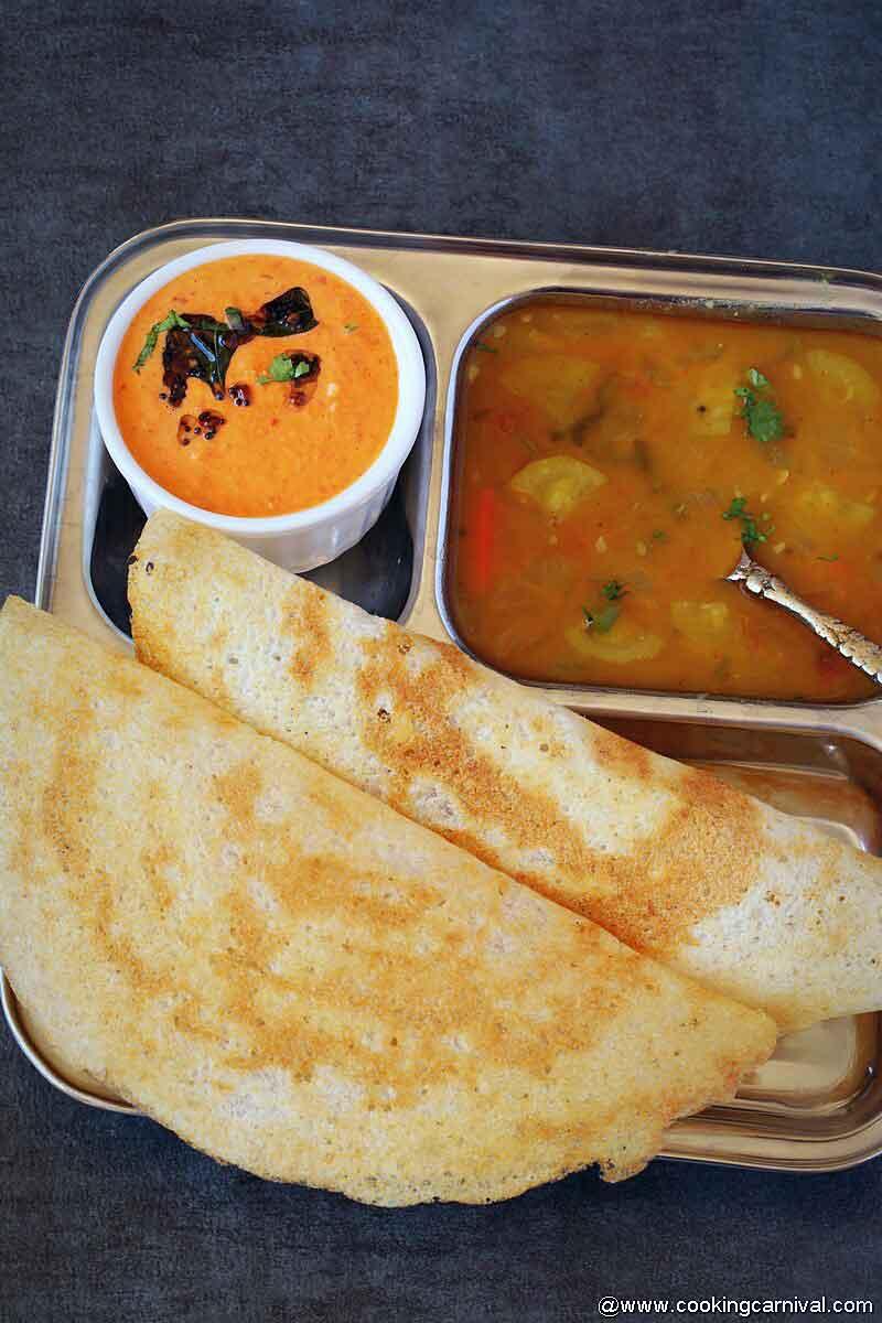 Crispy dosa, sambar and onion chutney in a steel plate