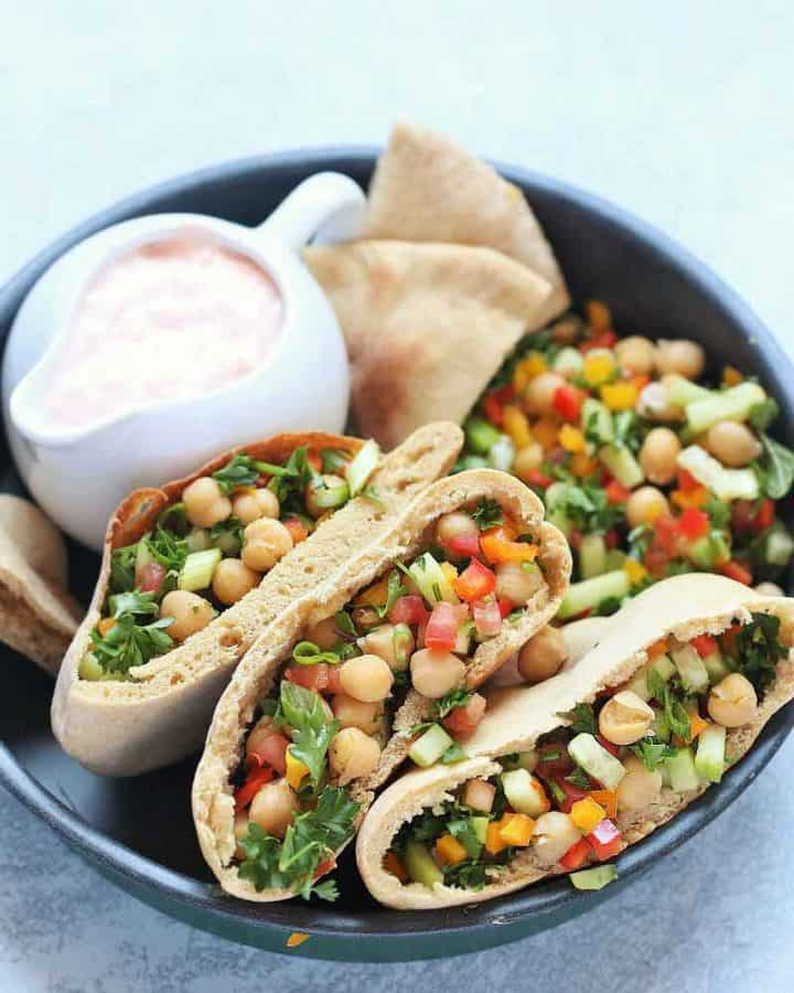 Balela Salad (Bah-lay-la salad) is Middle Eastern-style Chickpea salad. This hearty refreshing salad is bursting with zesty flavor. So easy, so delicious, nutrient dense and satisfying meal! It is perfect for any party or busy weeknight meal.