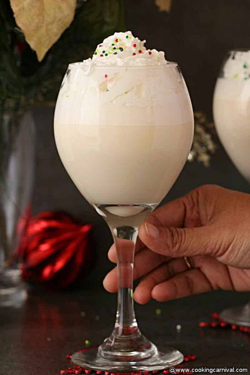 White Christmas Punch holding with hand
