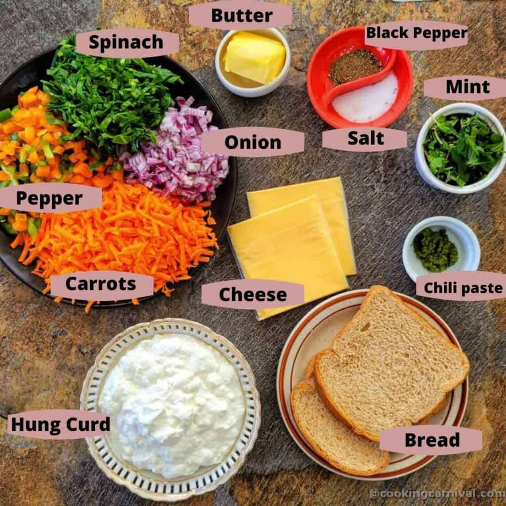 Pre measured ingredients for grilled sandwich on black tile