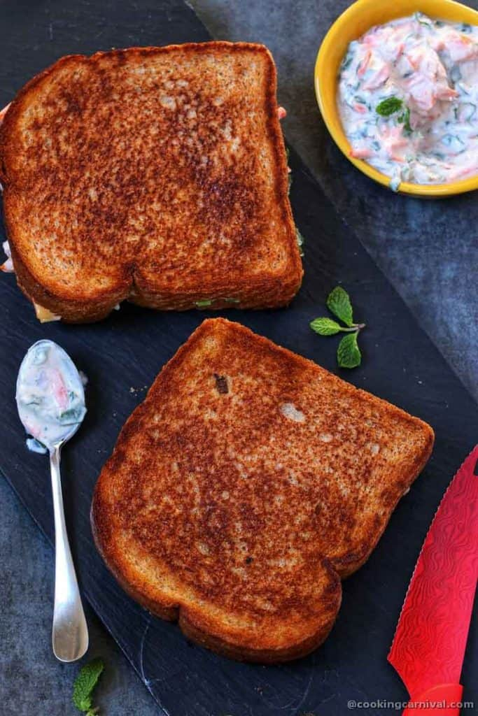 toasted sandwich on a wooden board