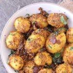 Chettinad Potato fry in white bowl