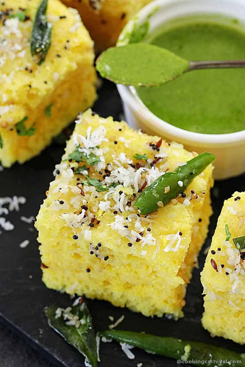 Khaman Dhokla with chutney on a cheese bowrd