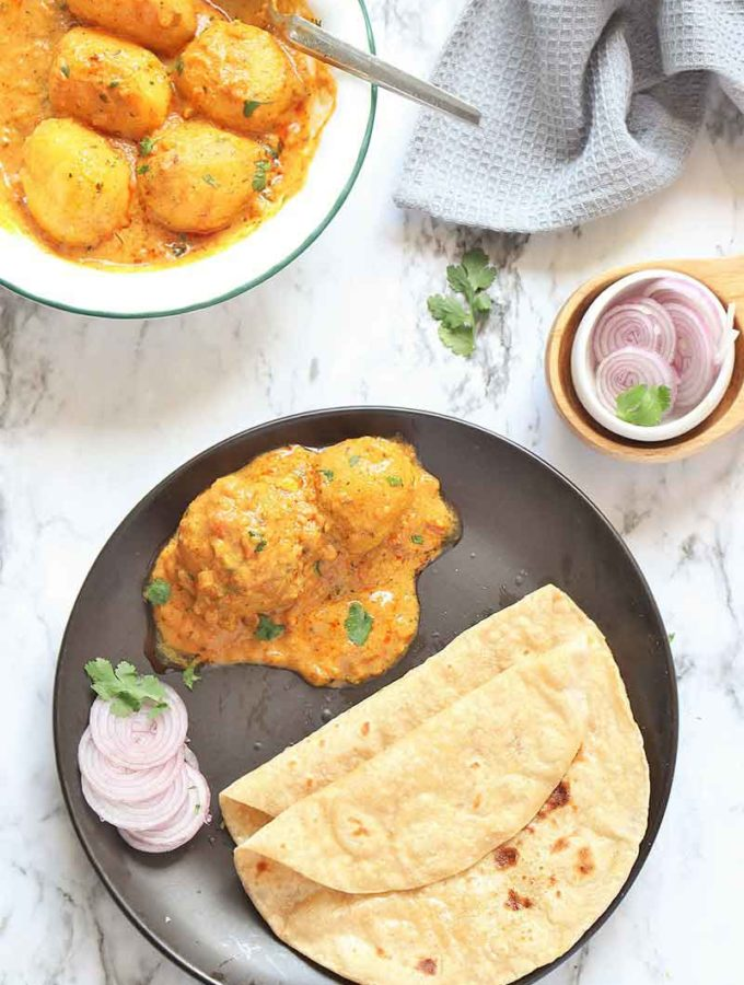 Instant Pot Dum Aloo - Best, Creamy, Scrumptious and Very Flavorful Indian Classic dish made of baby potatoes in a spicy onion-tomato-yogurt based gravy.