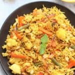Instant Pot Vegetable Biryani - A mouth watering, bold, flavorful, universally loved Indian One Pot Rice Dish which is packed with vegetables and flavorsome spices. Biryanis are one of the most royal and grand rice based dish from Indian Cuisine.