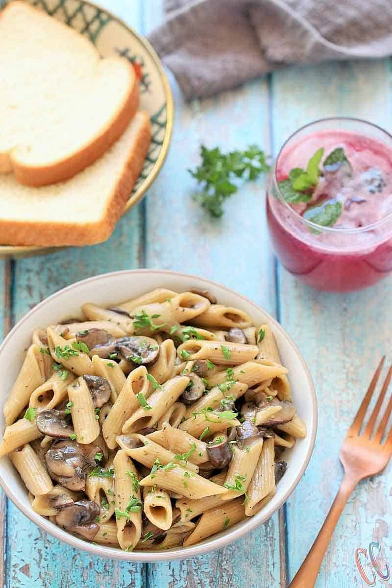 This Instant Pot Vegan Mushroom Stroganoff Recipe is quick, easy, comforting, hearty, savory, creamy, delicious, nut-free and perfect for weeknight Dinner.