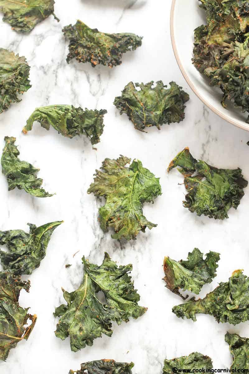 Baked Kale Chips - Simple, tasty, healthy, Flavorful and versatile snack that can be made at home very easily! These are very addicting healthy snack recipe. Once you start munching on them, you won't stop! So let's learn How To Make Kale Chips In the Oven. :)