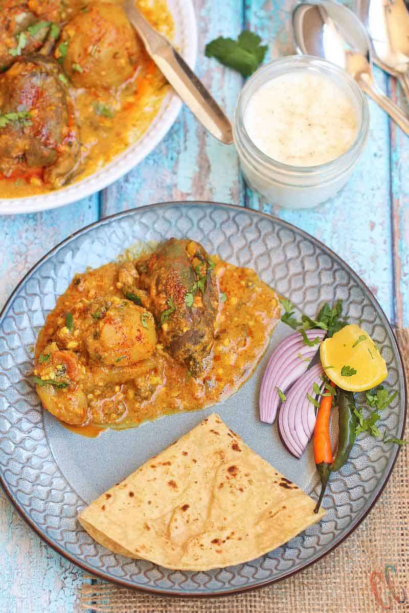 Instant Pot Stuffed Eggplant Potato Curry / Stuffed Aloo Baingun In Pressure Cooker - Simple Flavorful curry that is made in one pot - Instant Pot / Pressure cooker. Pair it with Rice, Roti, naan, Bajri rotla or any Indian Flatbread and you have a complete delicious meal ready on the table under 30 minutes. This recipe is Vegan And Gluten-free. Ringana Batata Nu Bharelu Shak and rotli