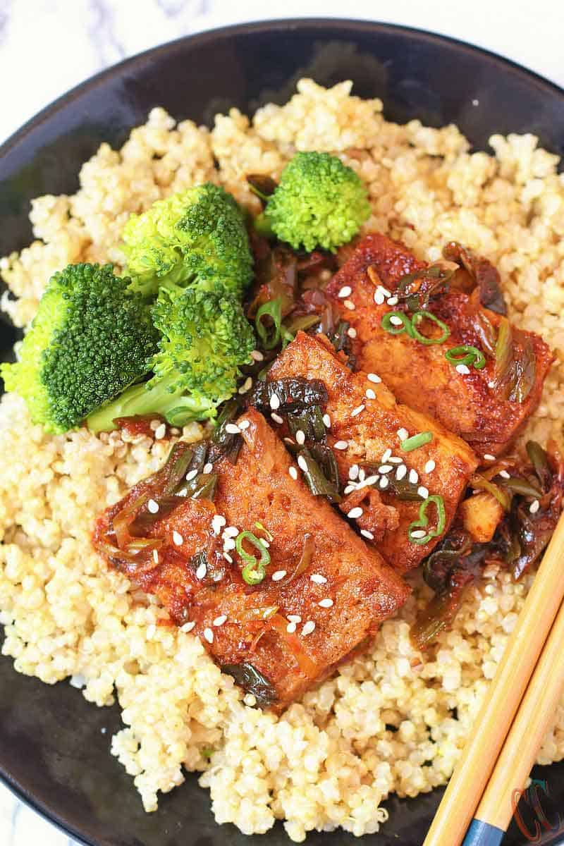 Spicy Braised Tofu / Dubu Jorim - A traditional Korean dish made with pan fried tofu, braised in a savory-spicy sauce with green onions and garlic. It's juicy, a little spicy and delicious. It is the best Korean Side Dish served with Rice, Noodles or with Coconut Quinoa.