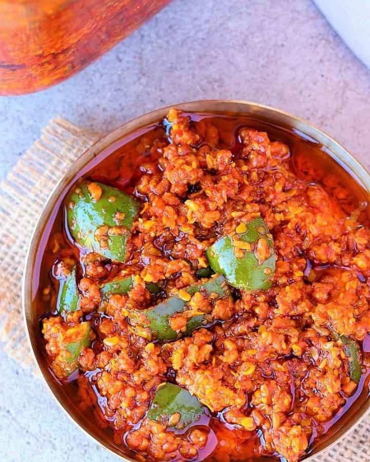 Mango Pickle | Gujarati traditional Methiya Keri Nu Athanu - Finger licking Pickle recipe Made with fresh raw mango, Methi Na Kuriya (coarsly crushed Fanugreek Seeds), Rai Na kuriya (Coarsely crushed mustard seeds), Salt, Red chili powder, Asafetida and Oil.