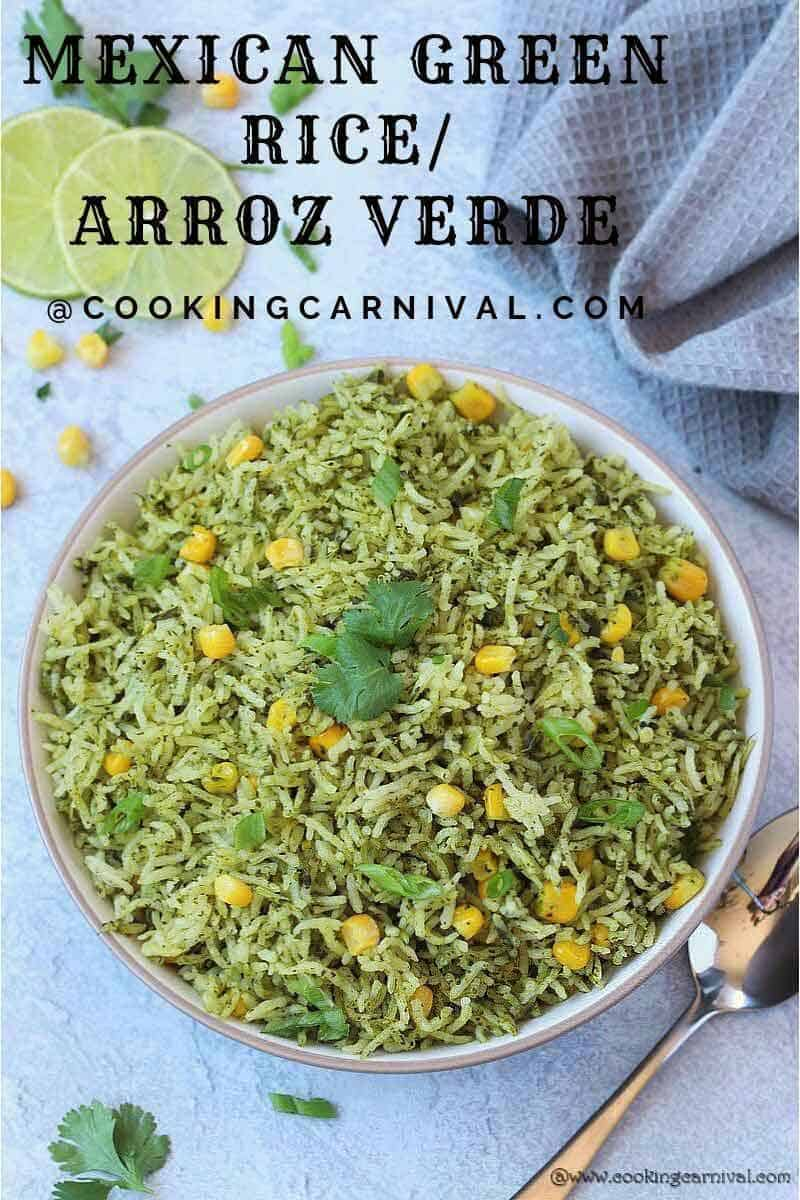 Arroz Verde in a White bowl, lemon slices, corn, cilantro and gray tea towel on the side
