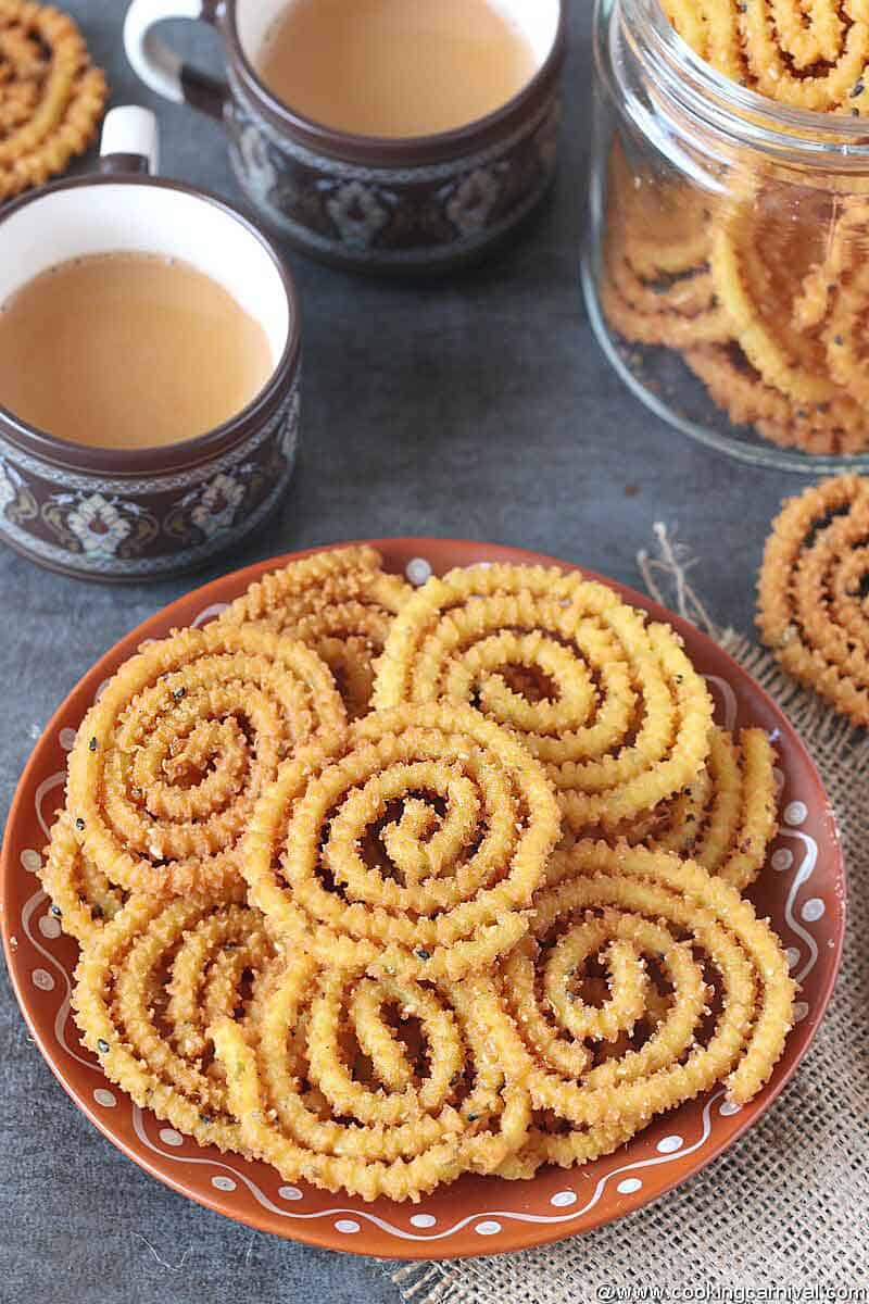 Chaklis in a brown plate with masala tea