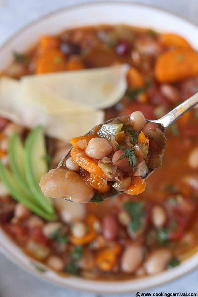 Beans soup in a spoon, closer shot