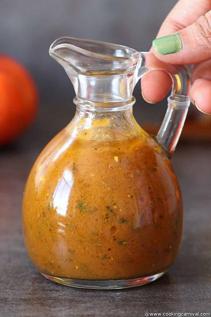 Holding bottle of Pumpkin-Vinaigrette