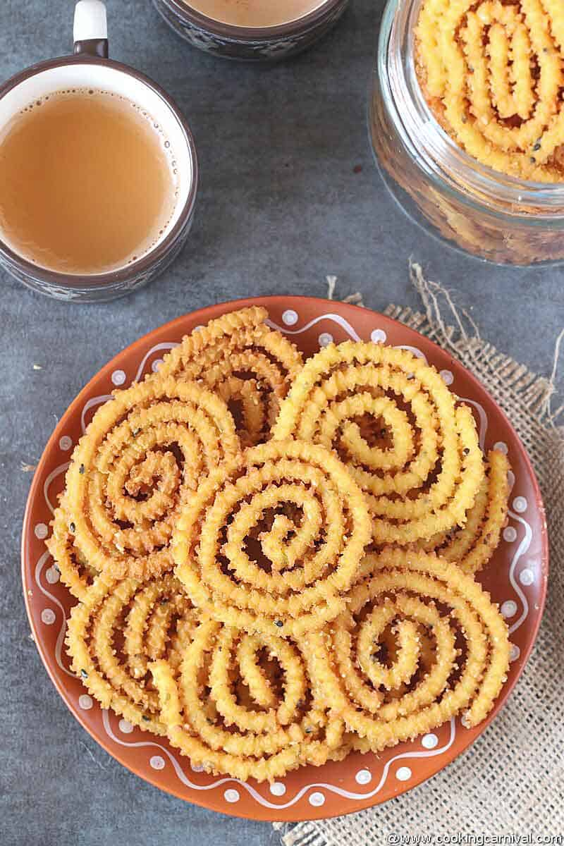 Chakli in a traditional plate with cup of masala tea