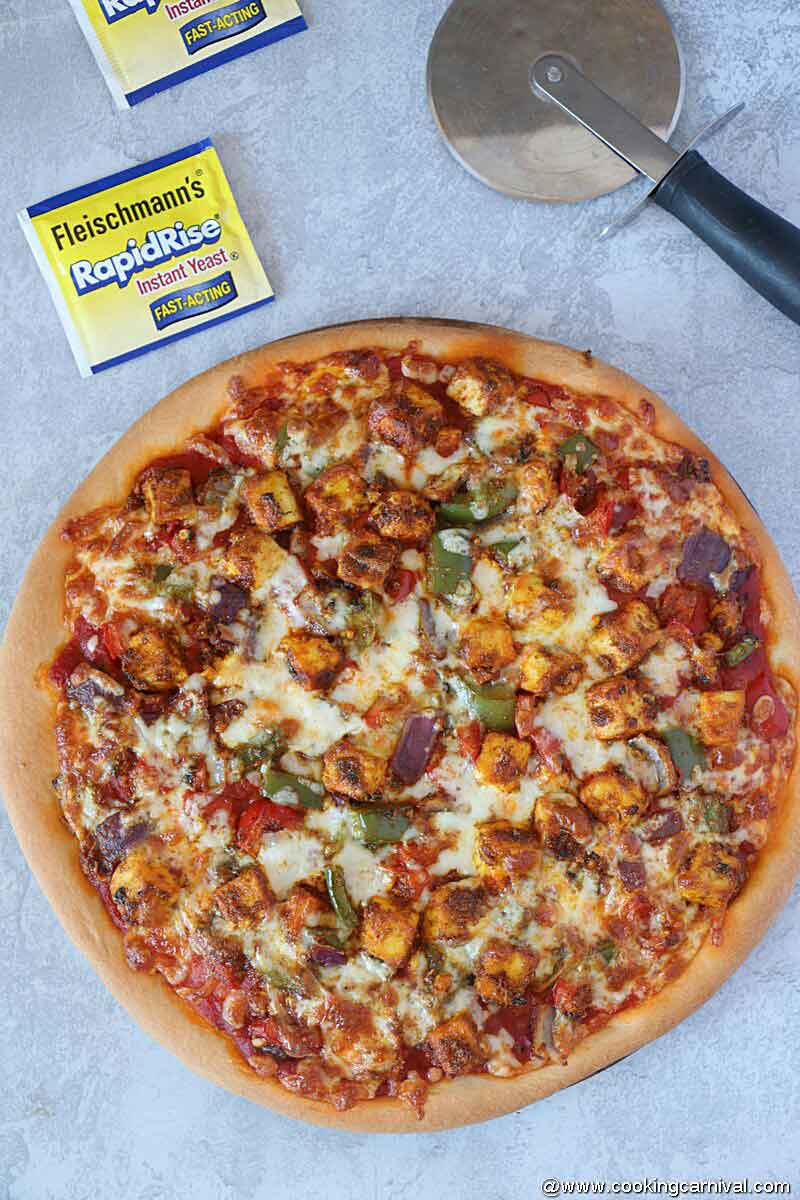 Paneer Pizza on a gray background