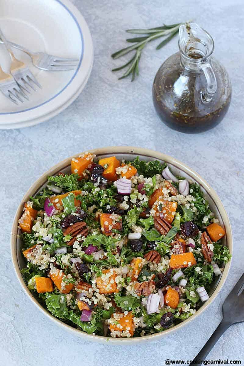 easy Roasted Butternut Squash Salad bowl on a gray board