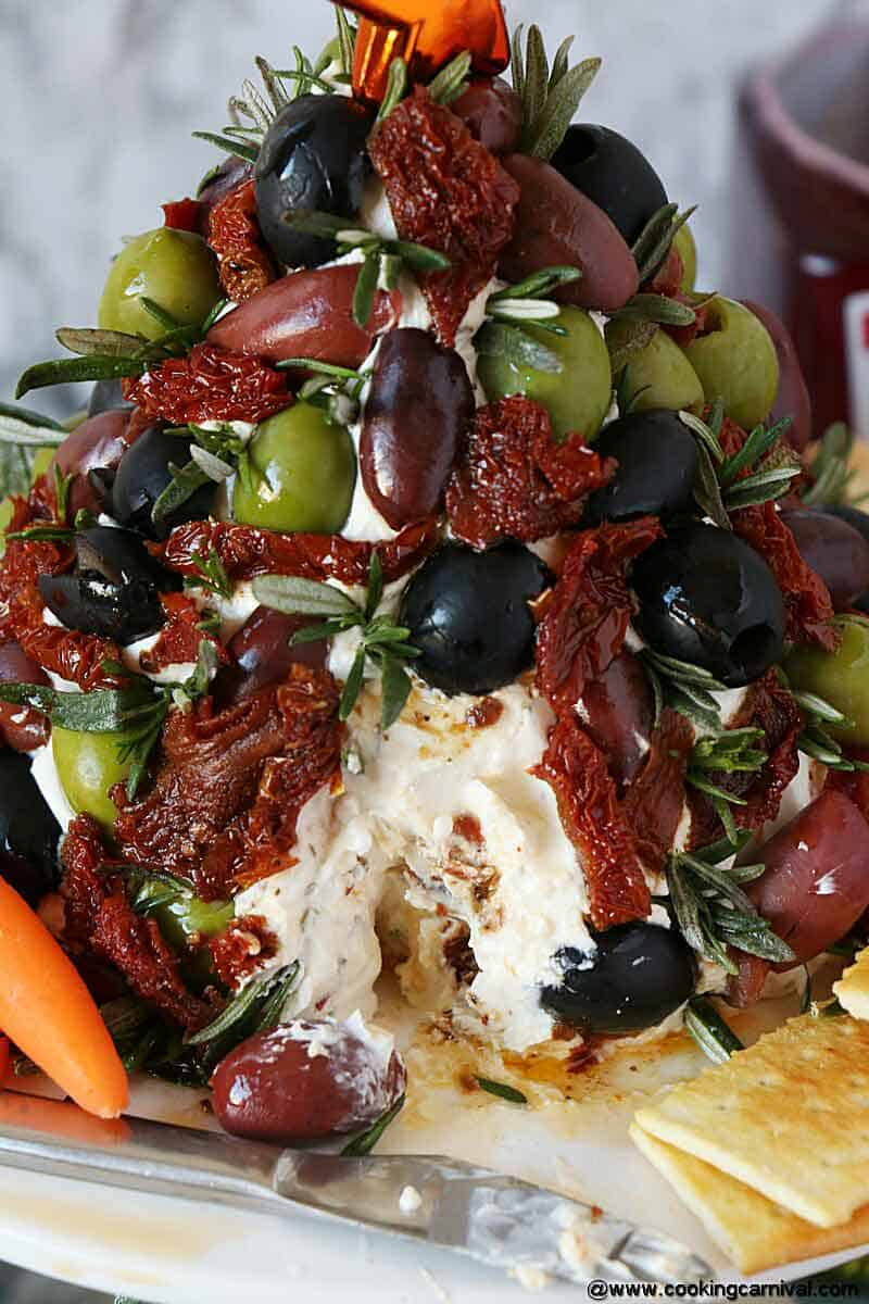 Antipasto Cheese Ball Christmas Tree with crackers and carrots