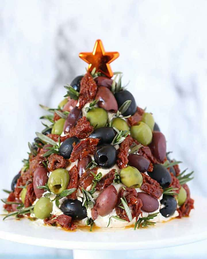 Antipasto Cheese Ball Christmas Tree on a cake stand