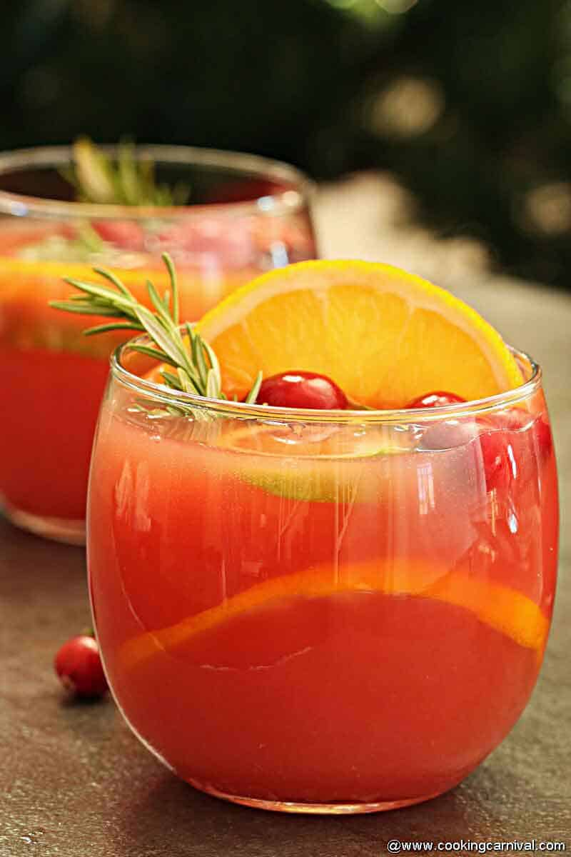 Non Alcoholic christmas punch in a 3 glasses and a jug