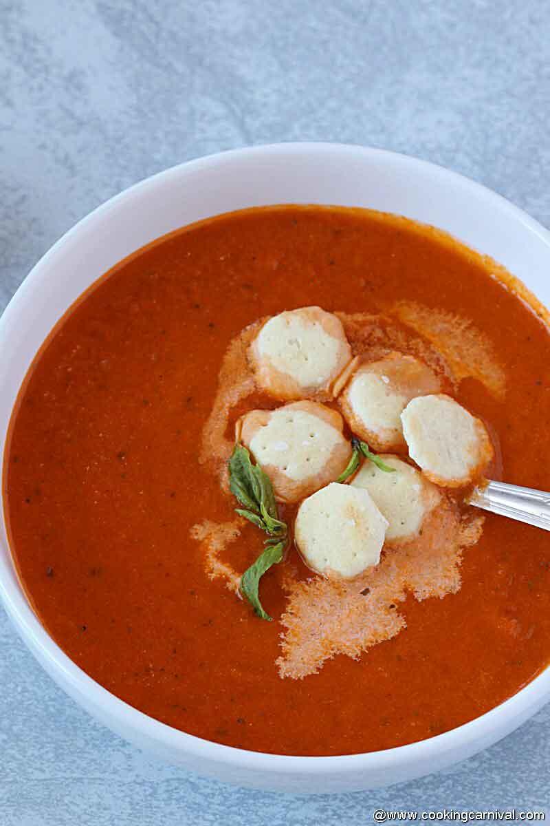 Easy tomato basil soup in white bowl in instant pot