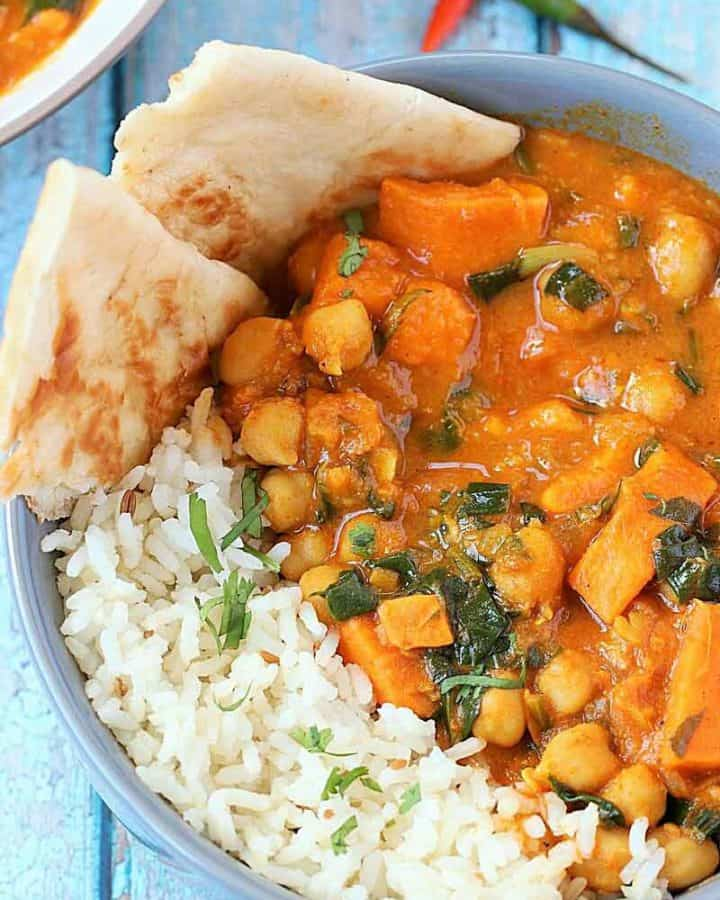 Instant Pot Sweet Potato Curry with rice and naan in gray bowl