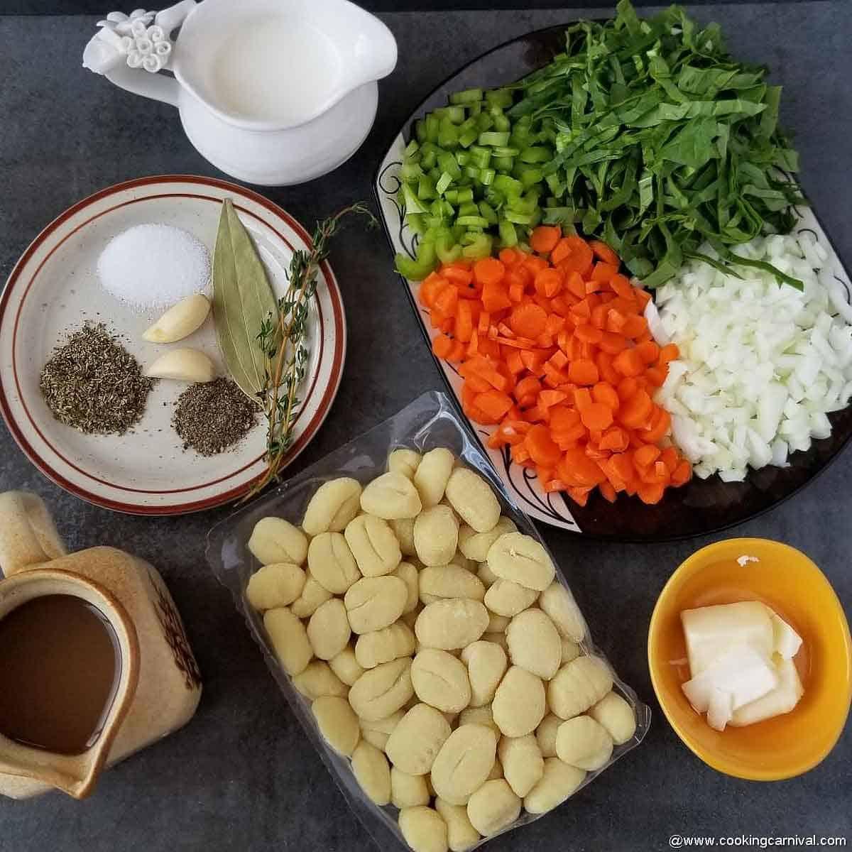 pre-measured ingredients of instant pot gnocchi soup on black backdrop