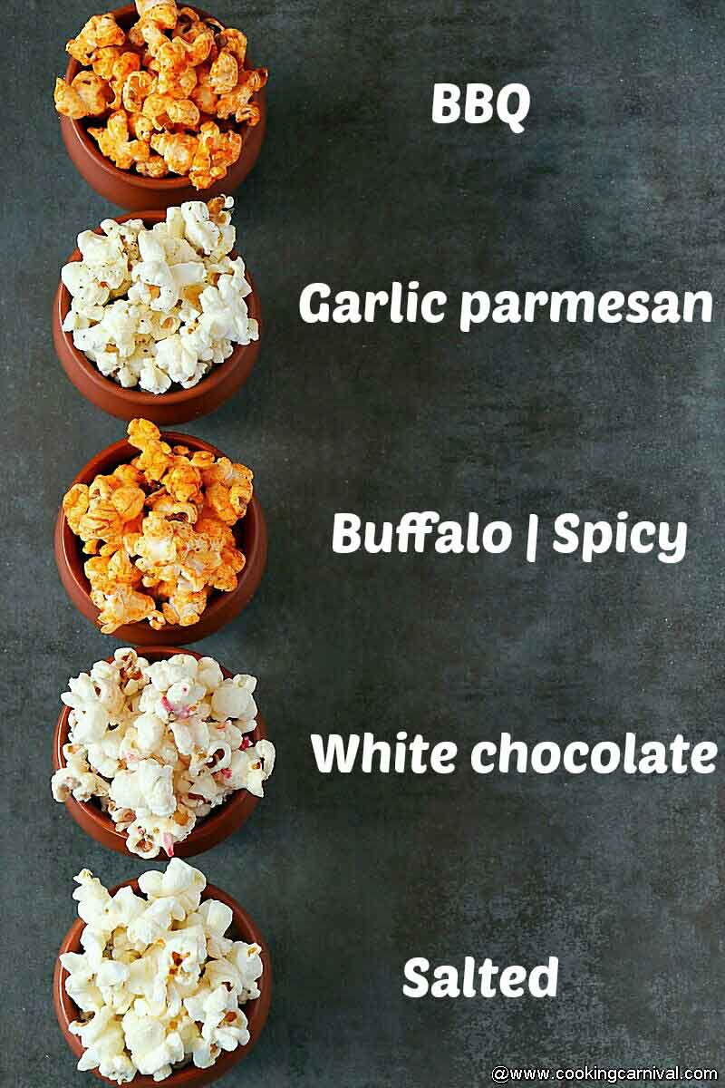 5 varieties of popcorn on a black tile