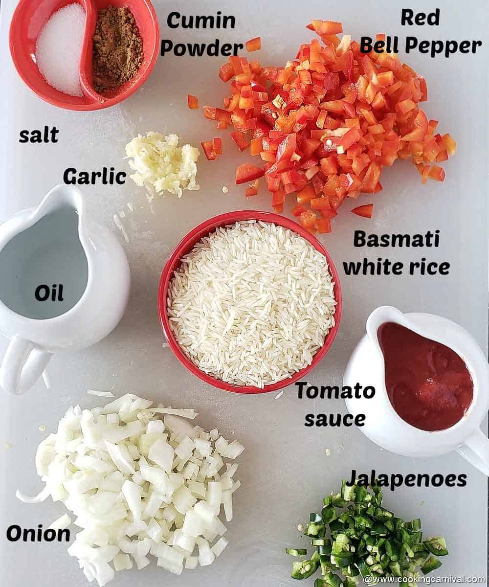 Pre measured ingredients on a white chopping board for Mexcian red rice