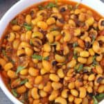 Side angle photo of Instant Pot Black Eyed peas served in white bowl