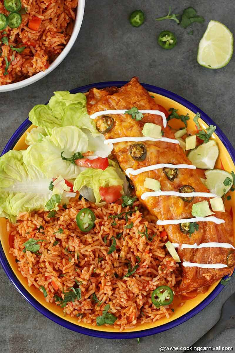 Mexican rice made in instant pot and served in yellow plate with enchilada and salad