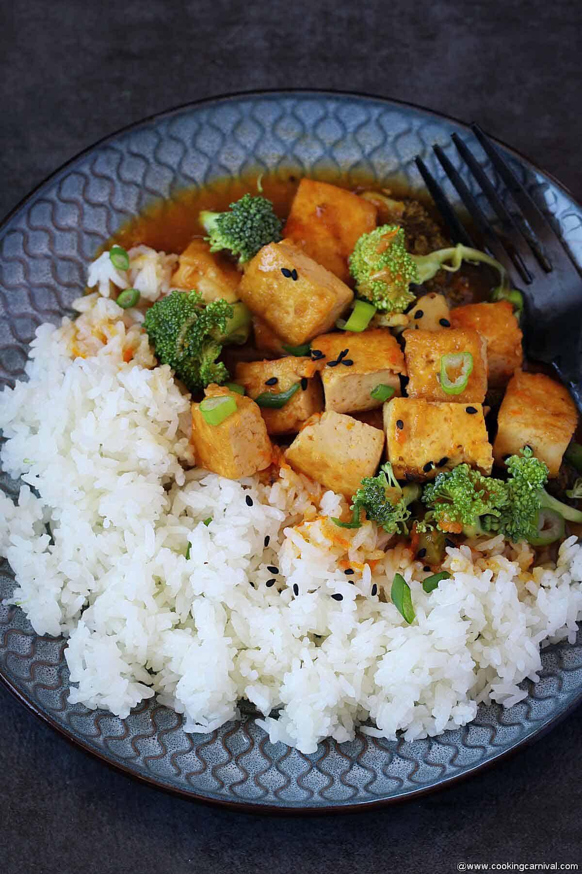 Jasmine rice with orange tofu broccoli in plate