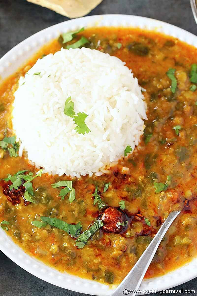 Dal palak on white plate with steamed rice