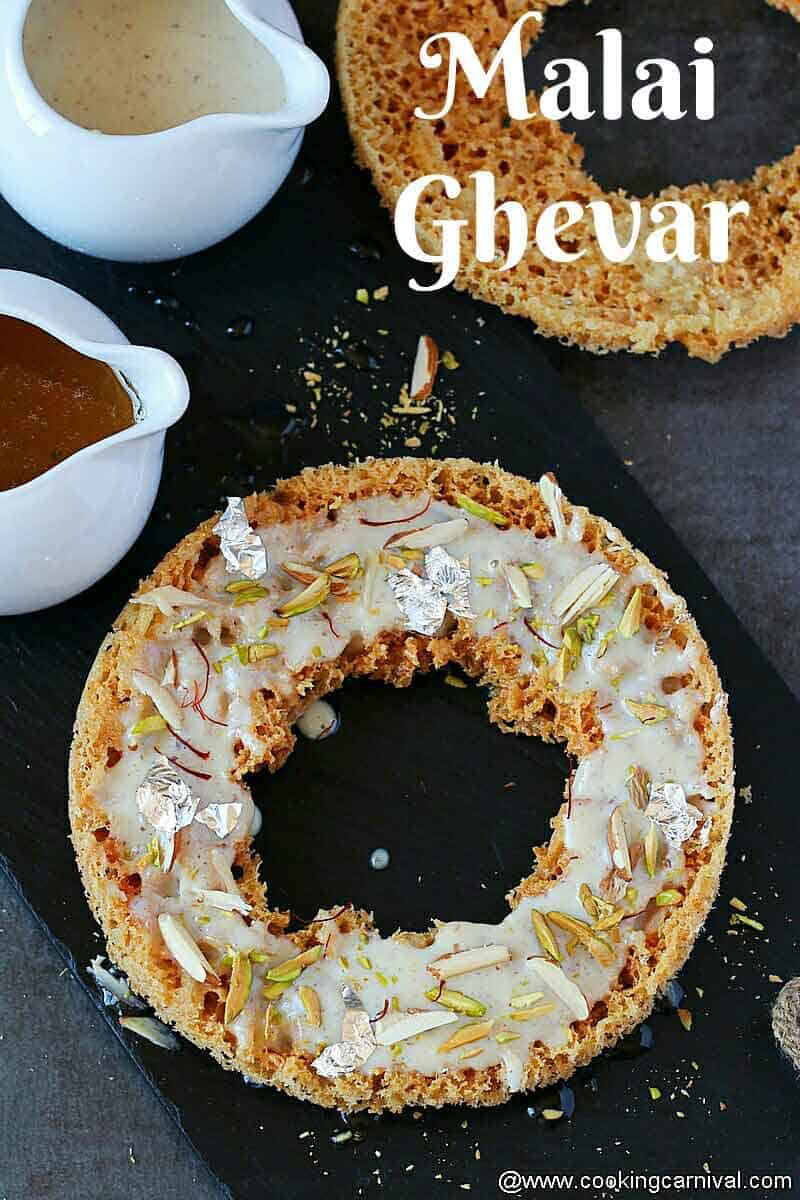 Ghevar on cheese board, sugar syrup and rabdi on the sides