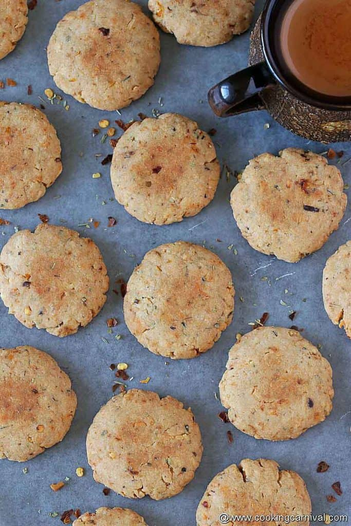 savory cookies on a black tile, chai on the sides