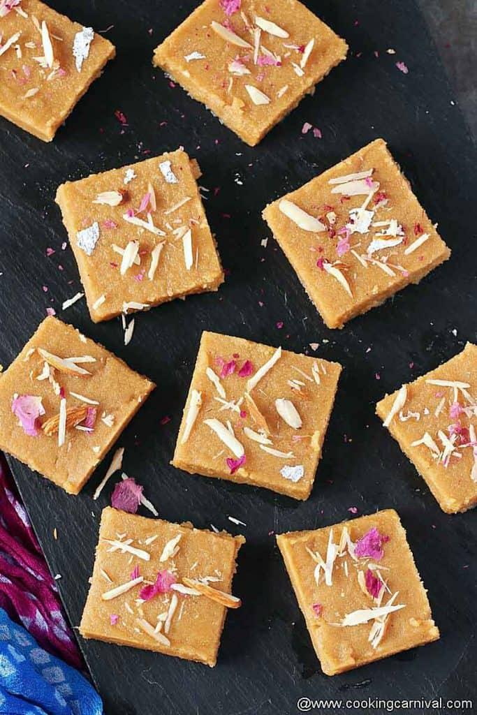Sukhadi squares on black cheese board