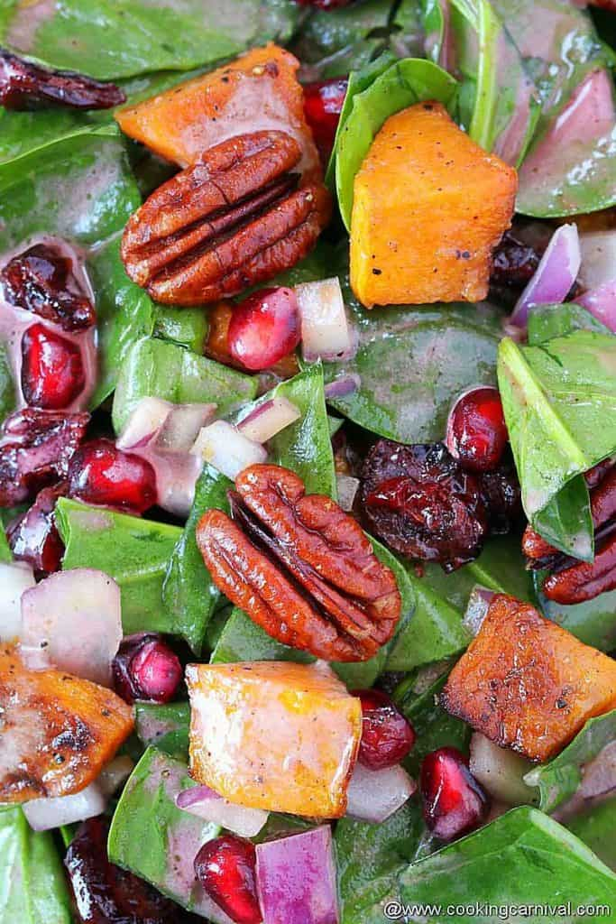 Close up look of Butternut squash spinach salad with pomegranate vinaigrette