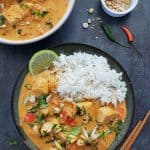 Tofu thai curry in a bowl served with jasmine rice