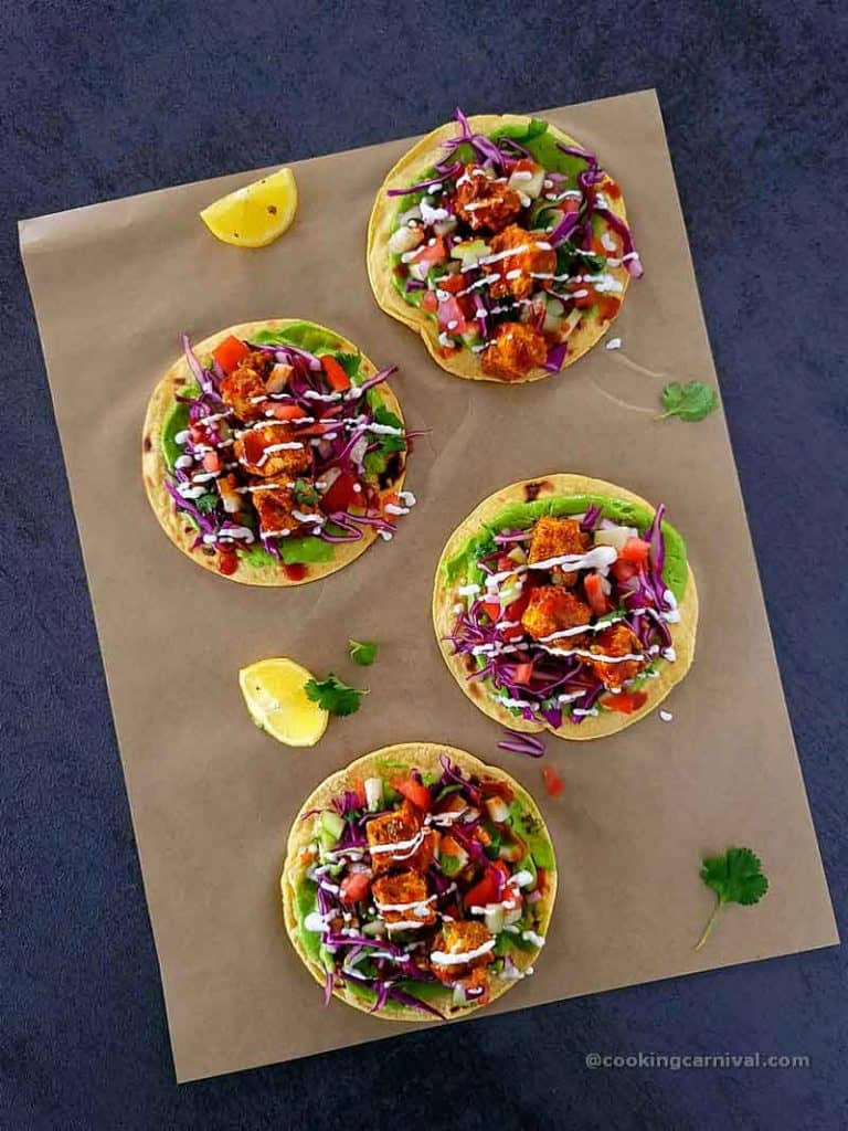 4 Achari paneer tacos on a tile