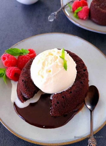 Eggless chcolate lava cake served with vanilla ice cream, berries and mint