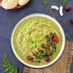 Green coconut chutney in a bowl, idli on the side