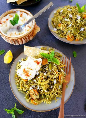 Pudina rice, curd and papad served in plate, curd bowl on the side